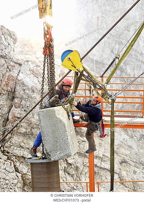 Germany, Bavaria, Garmisch-Partenkirchen, Zugspitze, installers working on goods cable lift