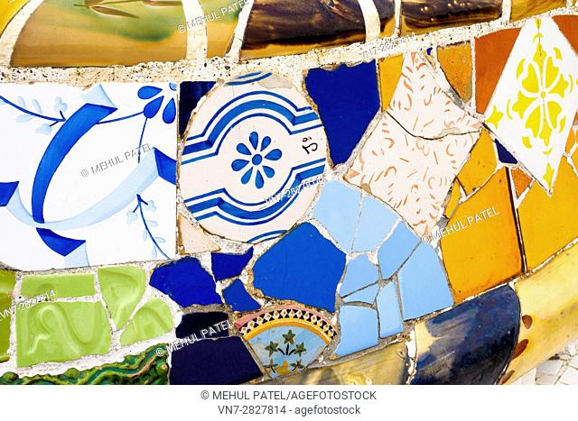 Close up of mosaic tiles on the benches in the main square (Plaça de la Natura) of Parc Guell, Barcelona - Catalonia, Spain