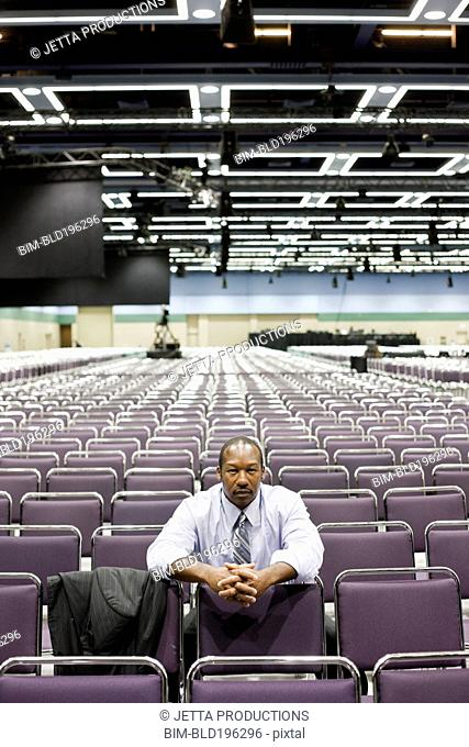 Black businessman waiting in empty conference room