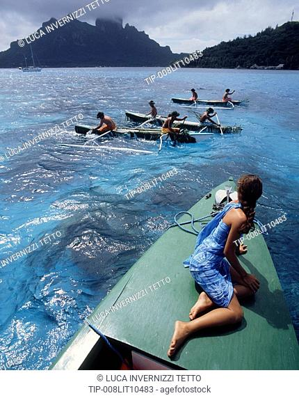 French Polynesia, Bora Bora, girl watching boat race
