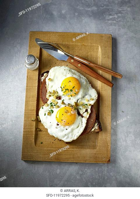 Liver spam and two fried eggs on a slice of bread