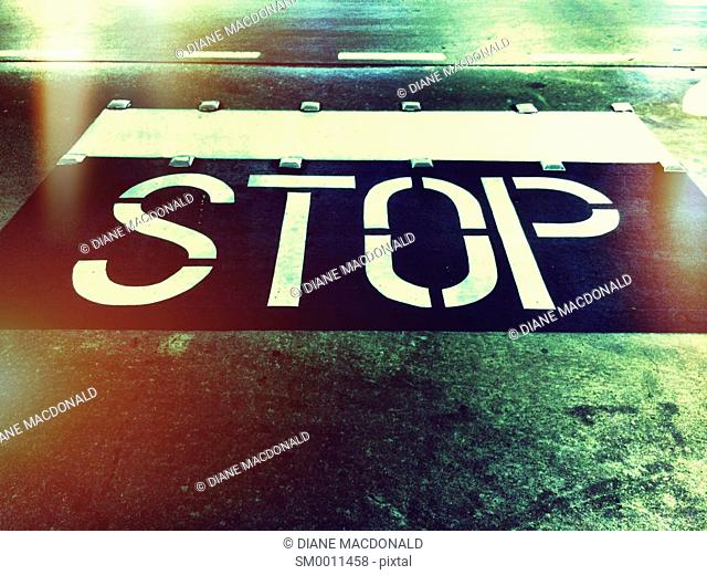 Stop painted on a road in a parking lot