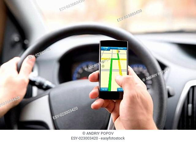 Man Using Gps In Cellphone While Driving