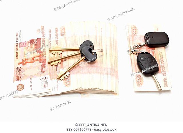 House and car keys on cash