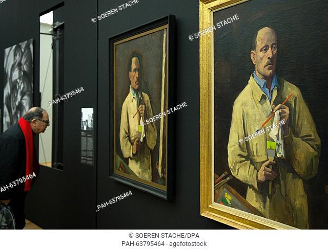 A man reads the information panel to a painting during a preview of the exhibition 'The Black Years. Histories of a Collection: 1933-1945' at the Hamburger...