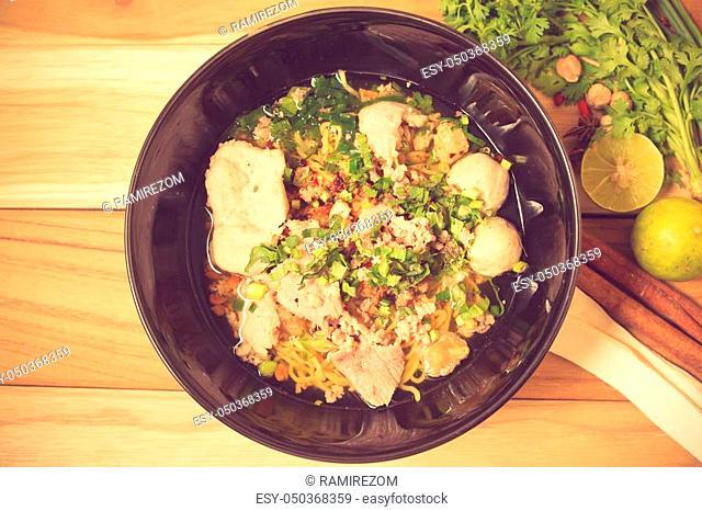 bowl of noodles with vegetables on wooden table. delicious noodle. Instant noodle. hot noodle. Homemade Quick Ramen Noodles Vintage color