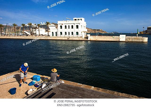 Fishermen, on Background Old building of the Racing Club, Antiguo edificio del Real Club de Regatas, Promenade, Mediterranean Sea, Cartagena City, Murcia Region