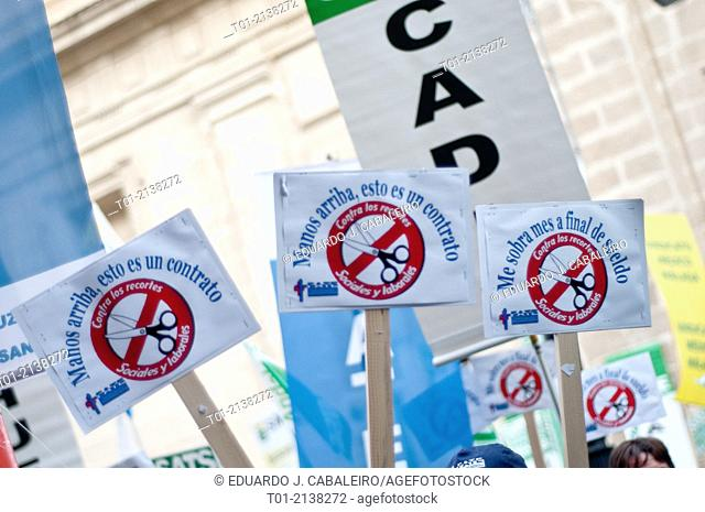 banners in a manifestation of public health officials in Seville on 16 of december of 2013