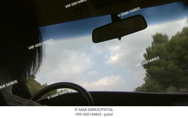 Woman driving car in countryside, Provence, France