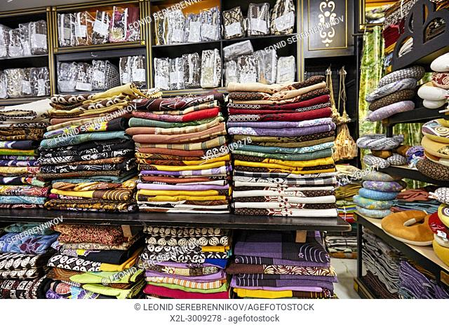 Stacks of folded batik shirts for sale in Hamzah Batik shop. Yogyakarta, Java, Indonesia