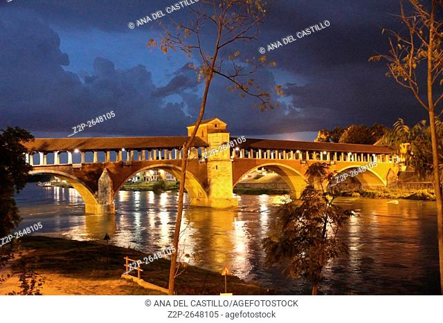 Pavia, with ''Ponte Coperto'' over the Ticino river during a night storm Lombardy Italy