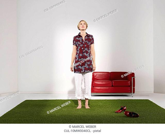 Woman standing on grass in green office