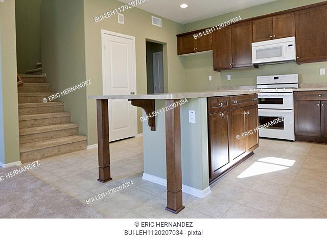 Kitchen having brown cabinets and island at home