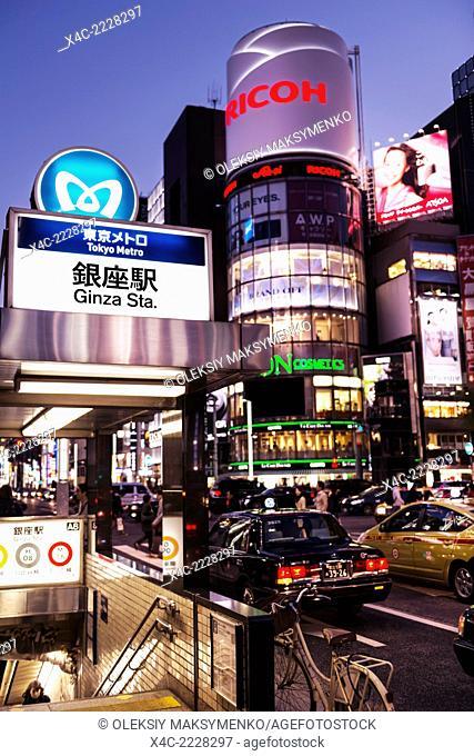 Ginza Tokyo Metro subway station entrance sign at night. Ginza, Tokyo, Japan 2014