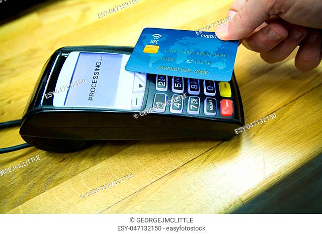 NFC Concept: Payment in a trade with nfc system and contactless card. All graphics are made up
