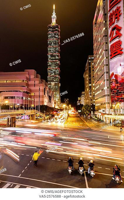 Taipei, Taiwan - night view of busy street and 101 tower