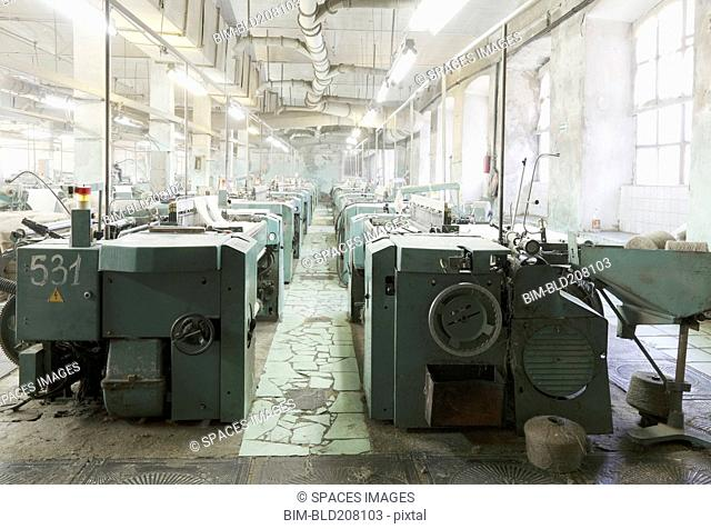 Industrial looms in textile factory