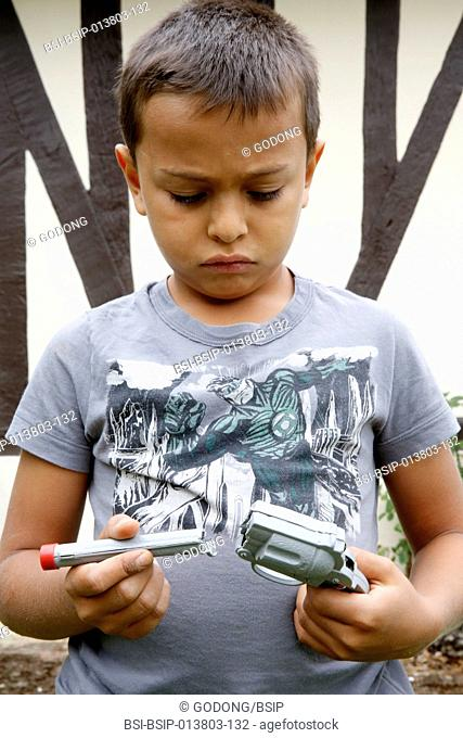 7-year-old boy holding a broken toy