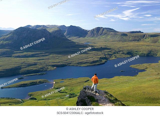A climber on Stac Pollaidh in Assynt Scotland UK