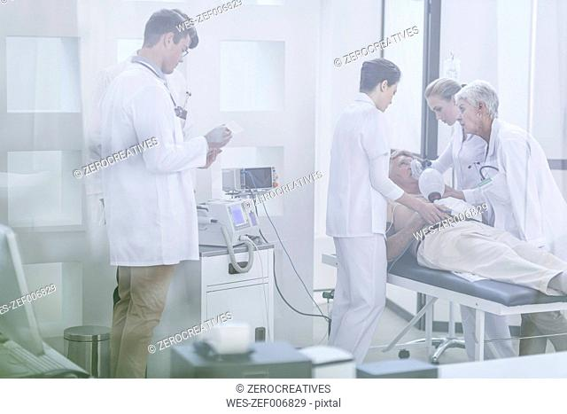 Hospital staff helping patient in emergency
