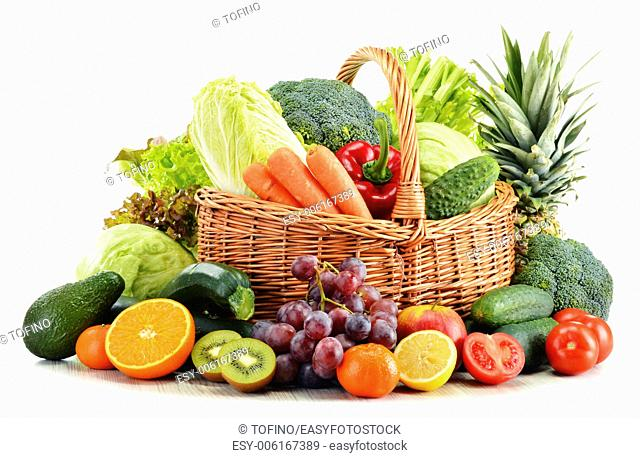 Wicker basket with groceries isolated on white background