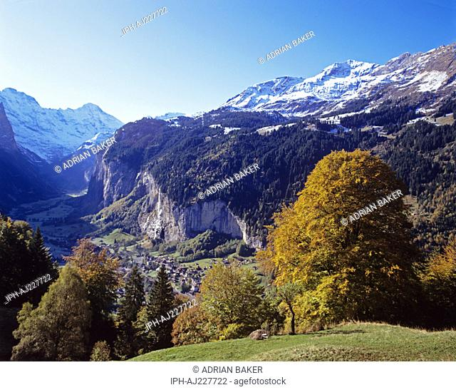 Autumnal view over the village and the Staubbach Falls in the Lauterbrunnen Valley