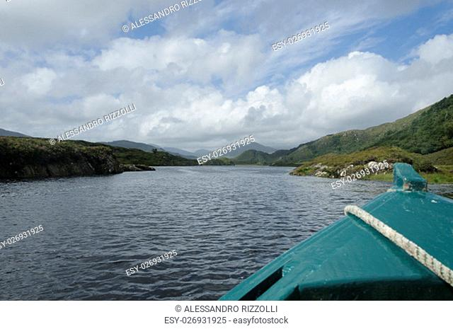A wooden boat on Lough Leane (Lower Lake) in Killarney National Park, County Kerry, Ireland, Europe