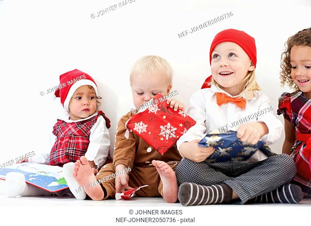 Small children with Christmas presents