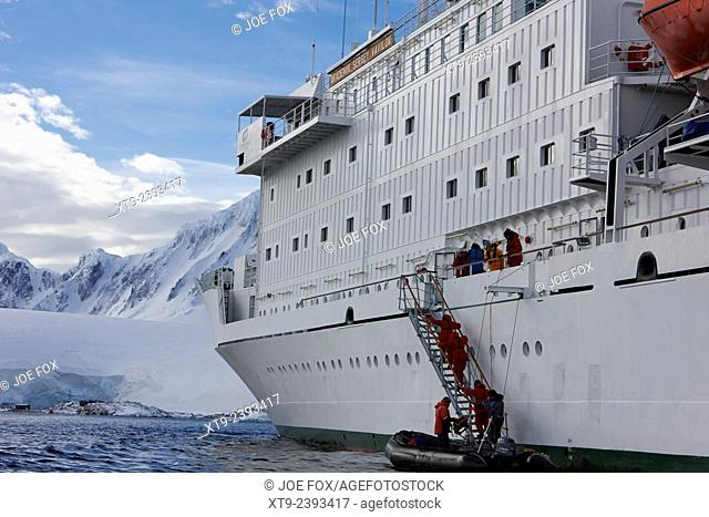 passengers on board a zodiac excursion returning to research ship in port lockroy antarctica