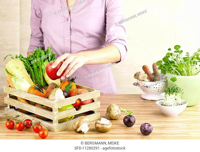 Fresh fruit and vegetables in a wooden crate