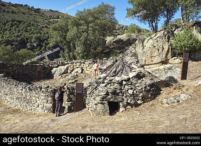 """Some visitors take a picture in the goat pen and chivitero of the Ethnographic Museum """""""" La Majada del Rostro """""""". Shepherd's sheepfold where a goat herder and..."""