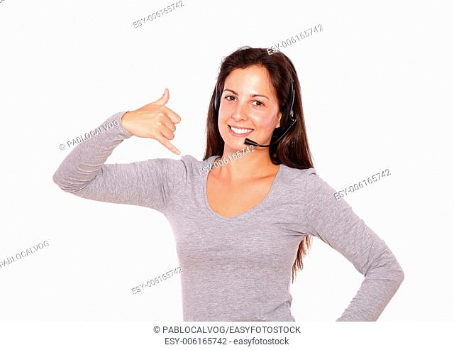 Portrait of a lovely lady talking on headphones with microphone on white background