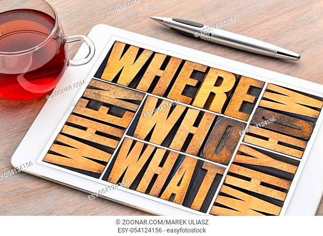 who, what, how, why, where, when, questions - brainstorming or decision making concept - a collage of words in vintage letterpress wood type on a digital tablet...