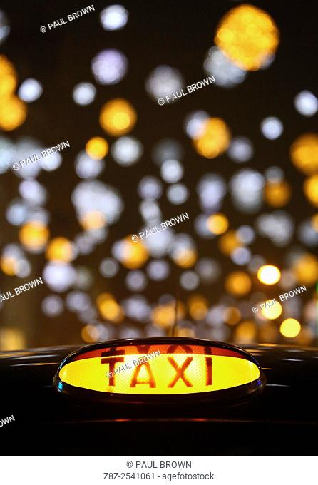 Black London taxi cab at the switching on of Oxford Street Christmas lights and Xmas decorations in London but some failed to switch on immediately and only...