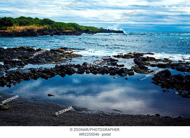 View of the ocean from the black sand beach in Hawaii