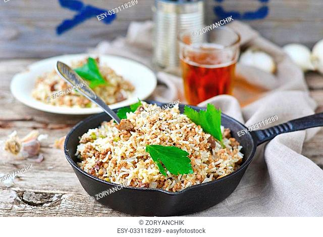 """Dirty rice is a delicious traditional Cajun rice dish which is made """"""""dirty"""""""" from the brown color of chicken liver and gizzards"""
