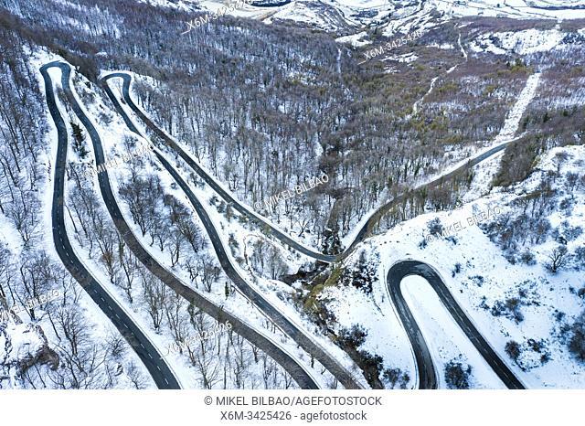 Snow-covered road. Olazagutia pass. Urbasa mountain range. Navarre, Spain, Europe