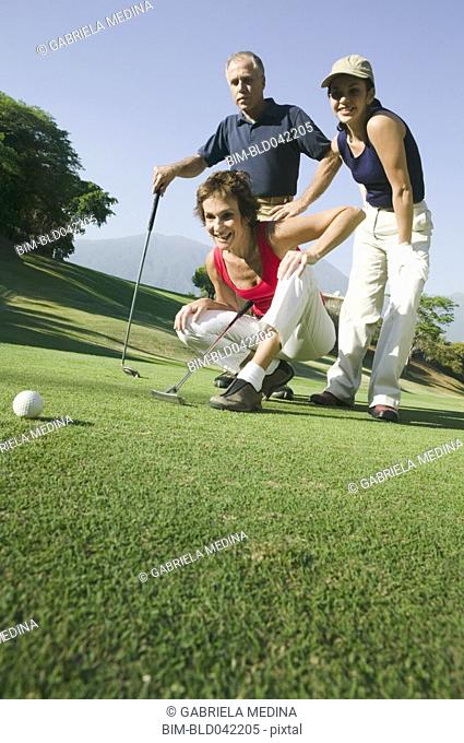 Multi-ethnic friends playing golf