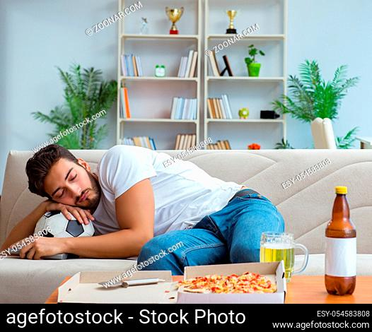 The man eating pizza having a takeaway at home relaxing resting