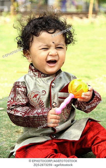 Cute little child with Khulkhula, also known as Maracas or Rumba shakers