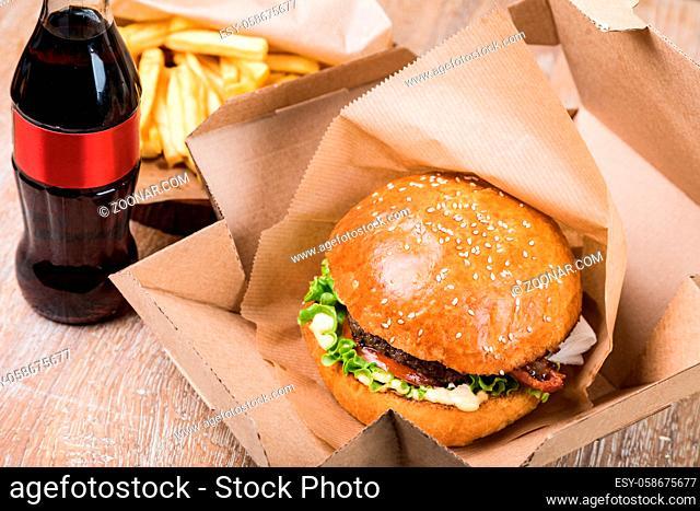 fresh tasty burger on wood table