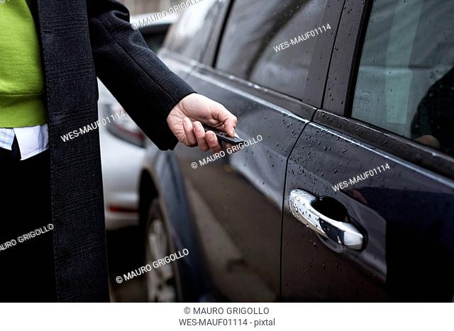 Close-up of businessman opening car with remote control