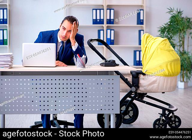 The young father looking after newborn in the office