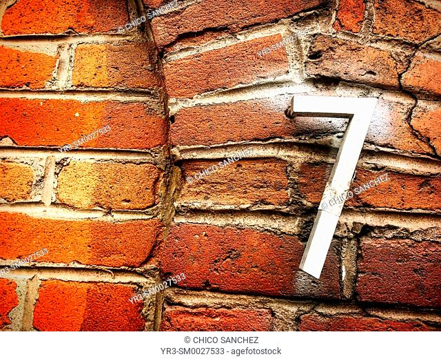 A number seven decorates a red brick wall in Coyoacan, Mexico City, Mexico