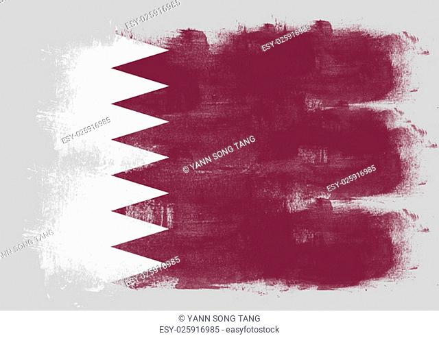 Flag of Qatar painted with brush on solid background
