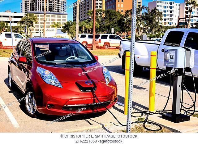 Electric car at a re-energizing station in the Sarasota Bayfront car Park Florida