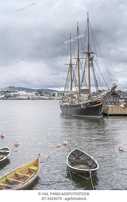 OSLO, NORWAY - July 21 2019: historical sail ship moored under a bright cloudy sky, shot under cloudy bright summer light on july 21, 2019 at Oslo, Norway