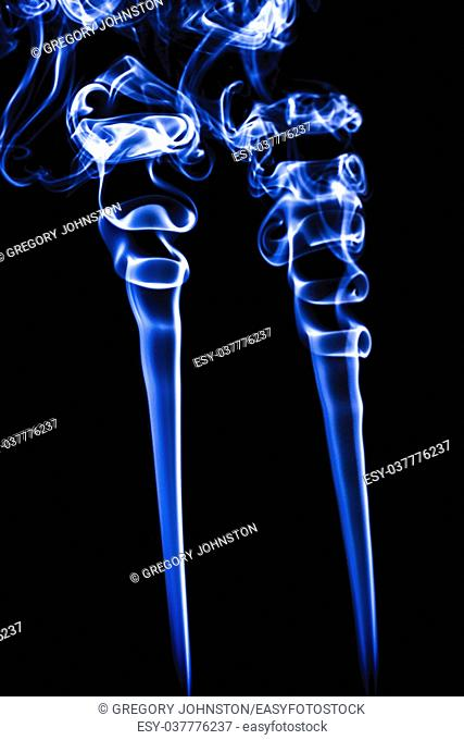 Conceptual image of trails of blue incense smoke making interesting shapes