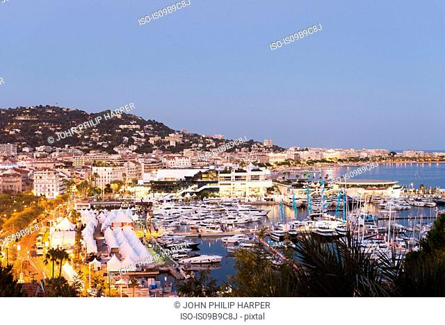 Cityscape with waterfront hotels and marina at dusk, Cannes, Cote d'Azur, France