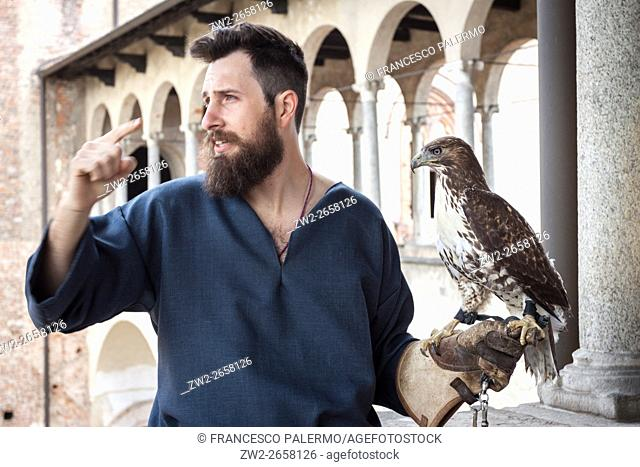 Expert falconer and splendid specimens of rapacious. Vigevano, Lombardy. Italy